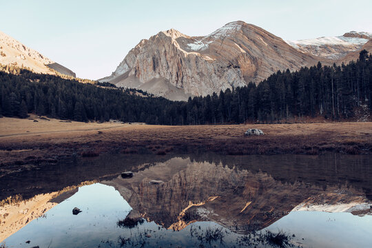 Reflection of mountain seen in puddle at Ibon Del Plan, Huseca, Spain