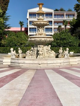 White historical fountain with statues.