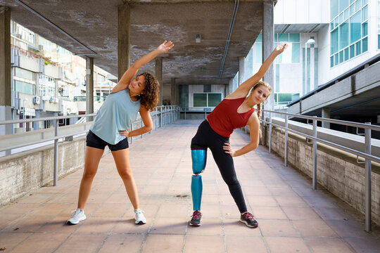 Athletes exercising together while standing on bridge