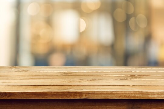 Empty wooden table top and blur with bokeh background