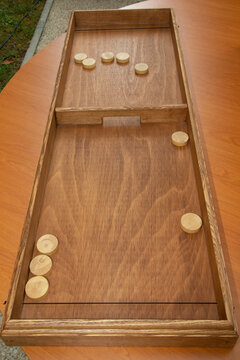 Vintage shuffle board game old wooden table toy with shuffleboard
