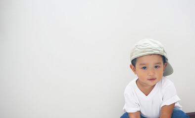 Fototapeta Portrait Of Baby Boy Against White Background