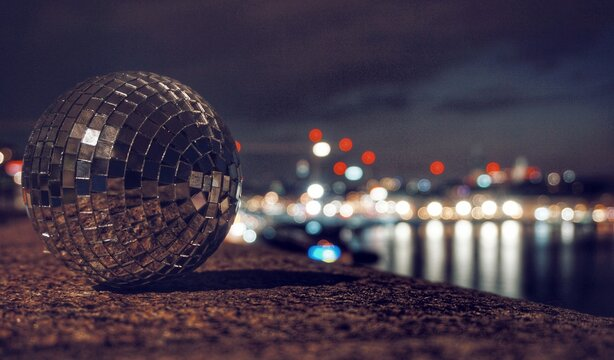 Illuminated Disco Ball At Night