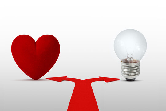 Two way arrows with heart and light bulb - Concept of choice between heart and mind