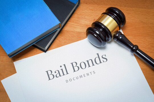 Bail Bonds. Document with label. Desk with books and judges gavel in a lawyer's office.