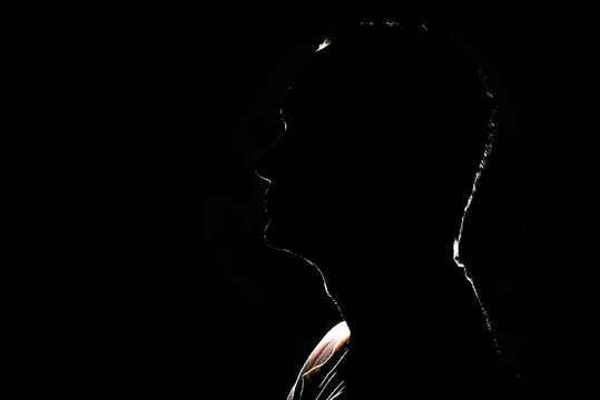silhouette of a human head on a black background