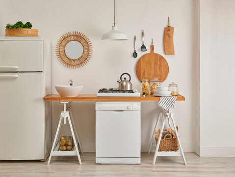 Decorative kitchen and dishwasher, refrigerator, sink and counter decorative style, lamp stone wall background.