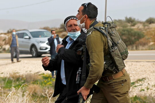 Palestinians protest against Israeli settlements in the occupied West Bank