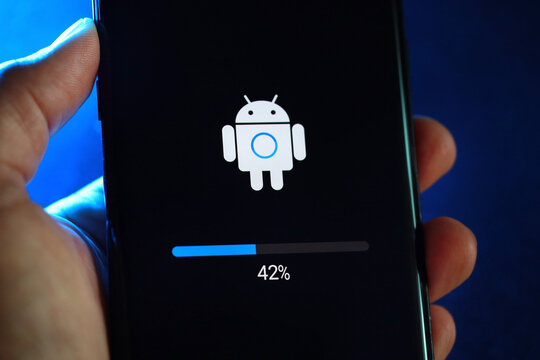 Android phone installing system update in progress. Android is a mobile operating system developed by Google. Soft focus image. PENANG, MALAYSIA - 14 JAN 2021.