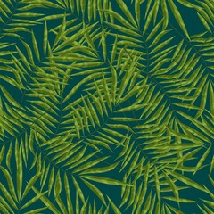 Leaf of a palm tree growing in a green tropical forest. Seamless background with pattern.
