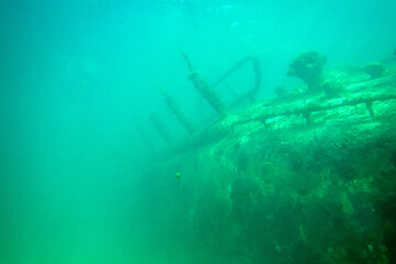 Close up of a wrecked ship beneath deep water