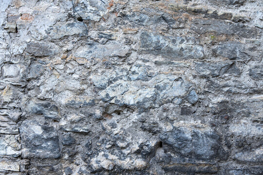 Background and texture of an old stone wall close up