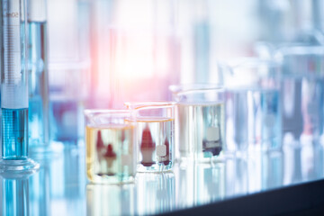 Obraz Close-up Of Liquid In Beakers On Table At Laboratory - fototapety do salonu