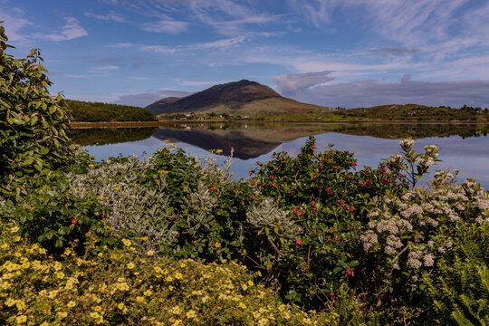 Tully mountain and reflection on Barnaderg Bay, Letterfrack, Connemara, County Galway, Ireland, wild atlantic way