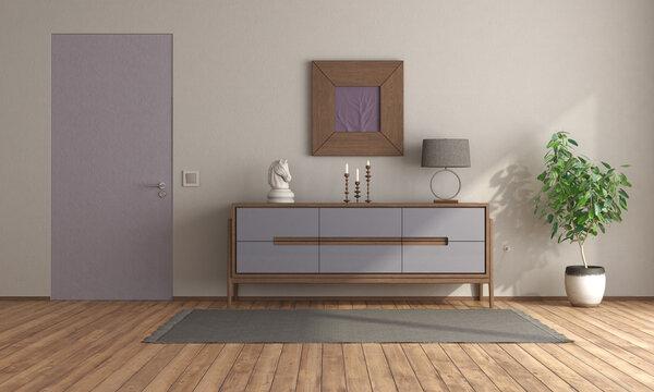 Minimalist room with purple sideboard and closed door