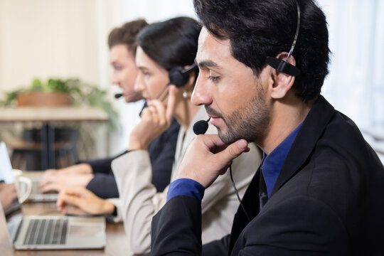 Side View of Telemarketing Colleagues with Headset Talking with Their Clients