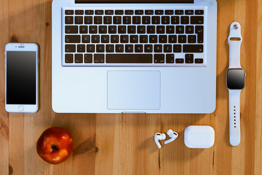 Apple brand products on a wooden table.