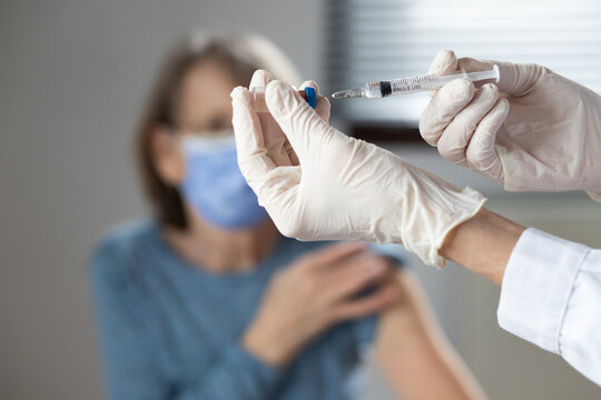 elderly woman getting coronavirus vaccine