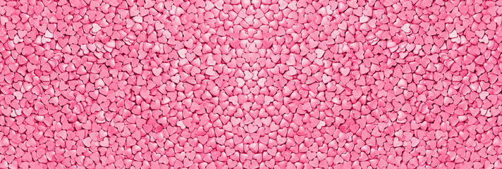 Trendy monochrome shiny silver raspberry pink hearts background of cake candy sprinkles in flat lay with copy space, for feminine blogger or festive love concept banner