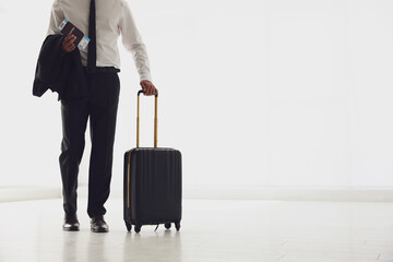 Businessman with black travel suitcase in airport. Space for text