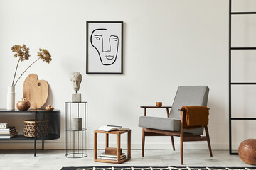 Stylish scandinavian composition of living room with design armchair, black mock up poster frame,...
