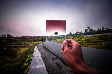Canvas Prints Black Cropped Hand Person Holding Glass Against Road And Sky