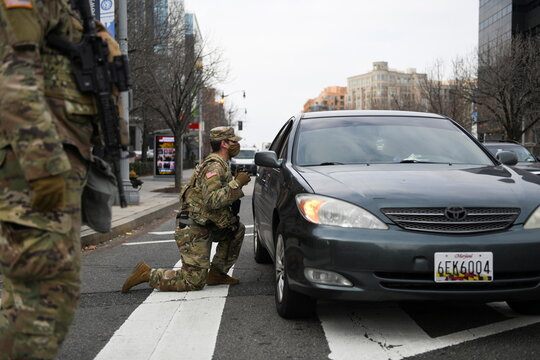 Members of the National Guard assist traffic in downtown Washington D.C., ahead of U.S. President-elect Joe Biden's inauguration