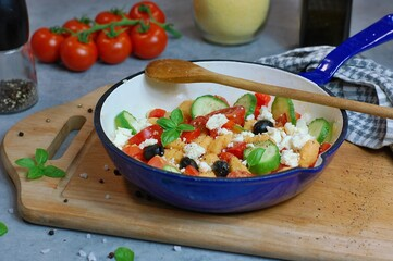 Wall Mural - Fresh salad with polenta gnocchi, red pepper, black olive, cucumber, basil and greek cheese