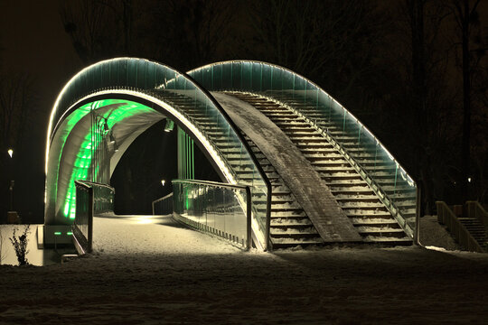The bridge in the People's Park in Lublin illuminated with LED light - green