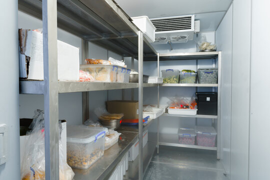 Refrigerator chamber with steel shelves in a restaurant