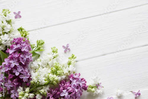 Lilac  blooming branches  on white wooden board.  Spring template . Spring background with empty space for Mother's day, women's day, 8 march, birthday, easter, wedding invitation