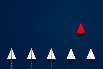 一歩先行く赤い紙飛行機。新しいアイデア・ビジネス、先行性、創造性、ソリューションのビジネスコンセプト Wall mural