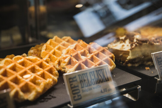 Krakow, Poland, August 2017: Appetizing waffles on a showcase of a cafe in Poland