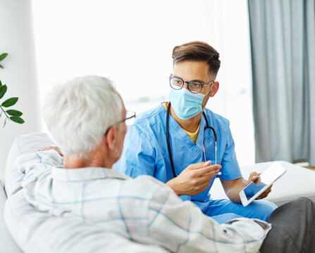 nurse doctor senior care caregiver help assistence retirement home tablet computer virus mask corona