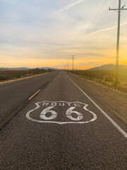 Route 66 Text On Road Against Sky During Sunset