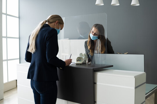 Hotel Reception Desk Protected By Medical Mask