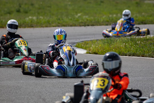 Unidentified pilots compete on the Atron track in the Rotax max Cup RAF series of sports karting, track race
