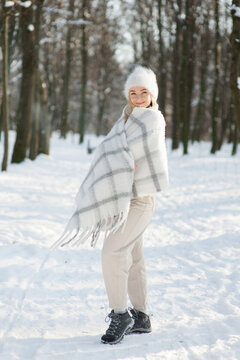 Cute young woman portrait, winter outdoor relaxation