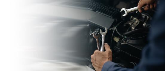 Obraz Car service, repair, maintenance concept. Auto mechanic working in garage. - fototapety do salonu