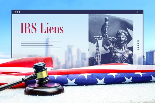 IRS Liens. Judge gavel and america flag in front of New York Skyline. Web Browser interface with text and lady justice.
