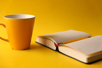 Notepad With Pencil And Coffee Mug On Yellow Background . - fototapety na wymiar