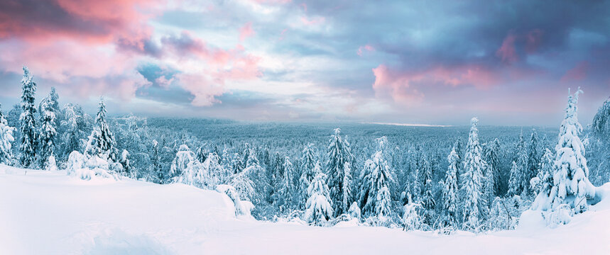 Panoramic landscape with blue color, mountains, forest, sunrise and snow cover. Ural, Russia Perm Krai Stone City.