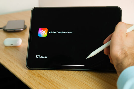 Adobe Creative Cloud is used with apple pencil on iPad Pro tablet . Man using application on the tablet. December 2020, San Francisco, USA.