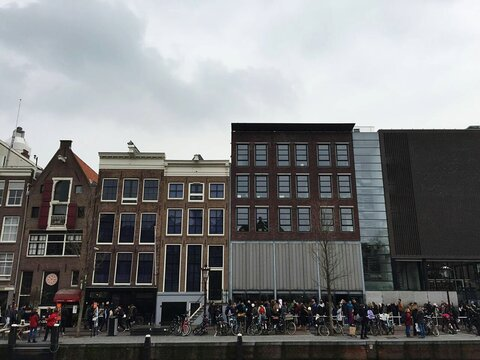 Low Angle View Of People By Anne Frank House Against Sky