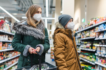 Family shopping in supermarket during covind19 pandemic