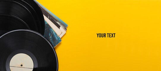 Fototapeta Vinyl record albums isolated on yellow background. Copy space. Top view obraz