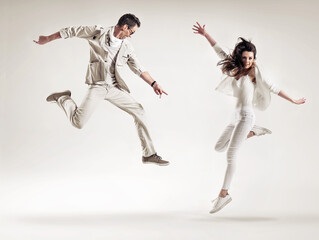 Two attractive dancers perforimg the dance show