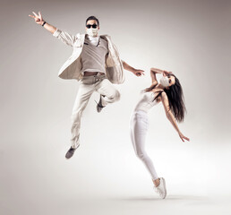 Two talented dancers wearing hygienic masks