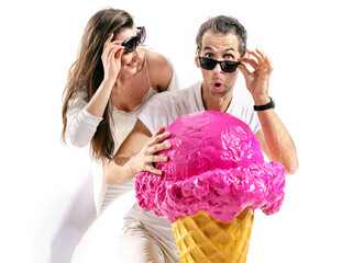 Cheerful couple looking at an amazing, huge ice cream