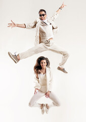 Talented couple dancing in a bright studio